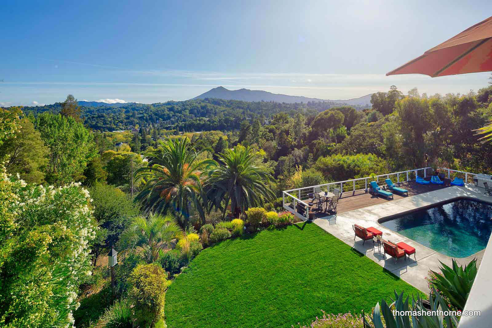 Swimming pool, lawn and view of Mt. Tamalpais in distance at 272 Fairhills Drive San Rafael