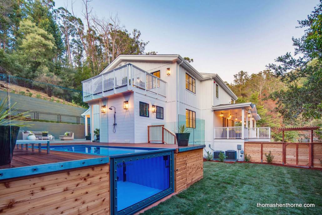 Modern farmhouse with shipping container pool