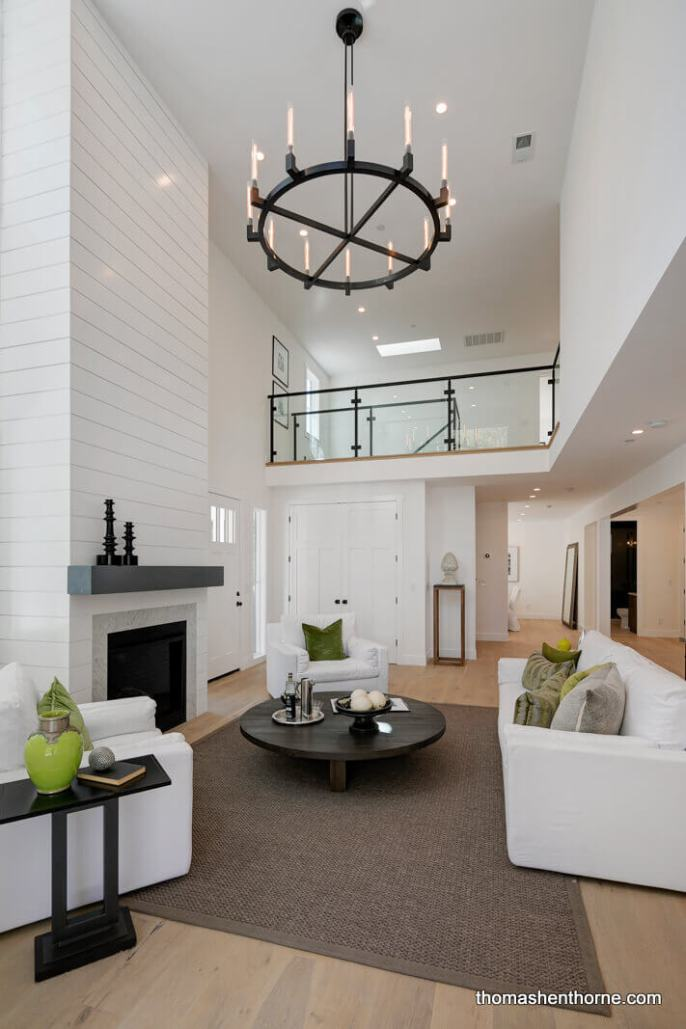 Living room with Restoration Hardware chandelier and 20 foot ceilings