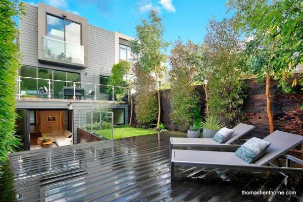 Back yard in San Francisco with deck and home in view