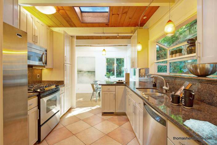 Kitchen with stainless appliances and skylight