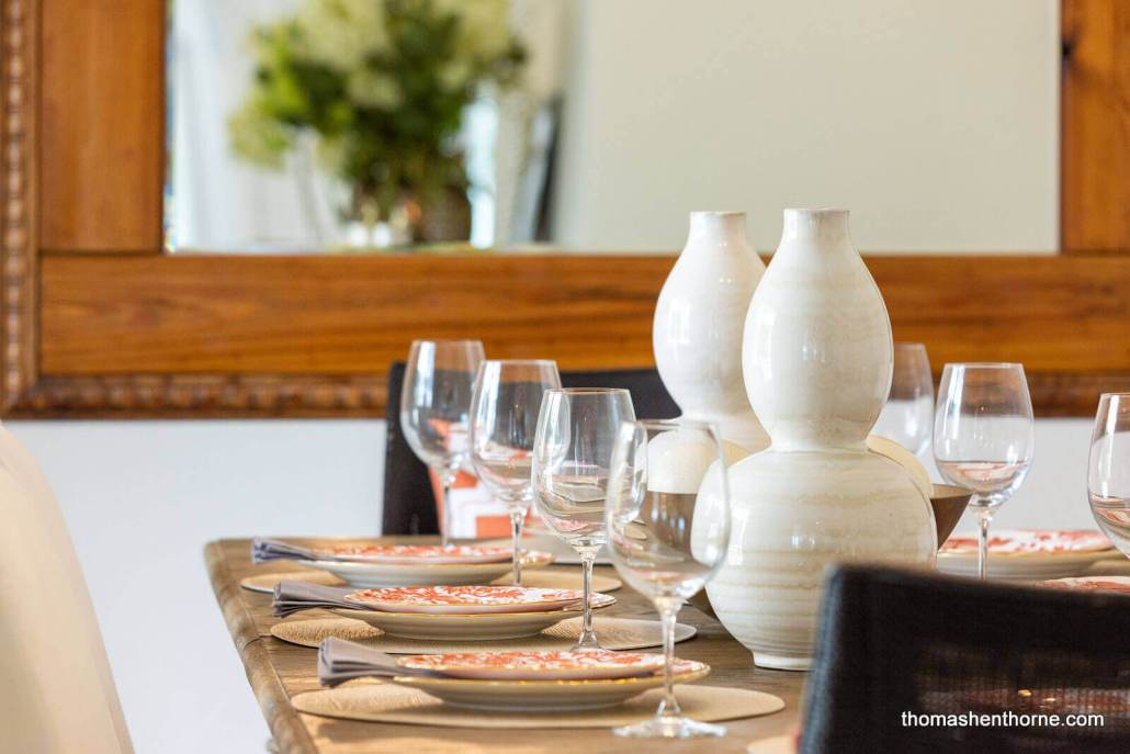 Close up of wine glasses and table settings on dining table