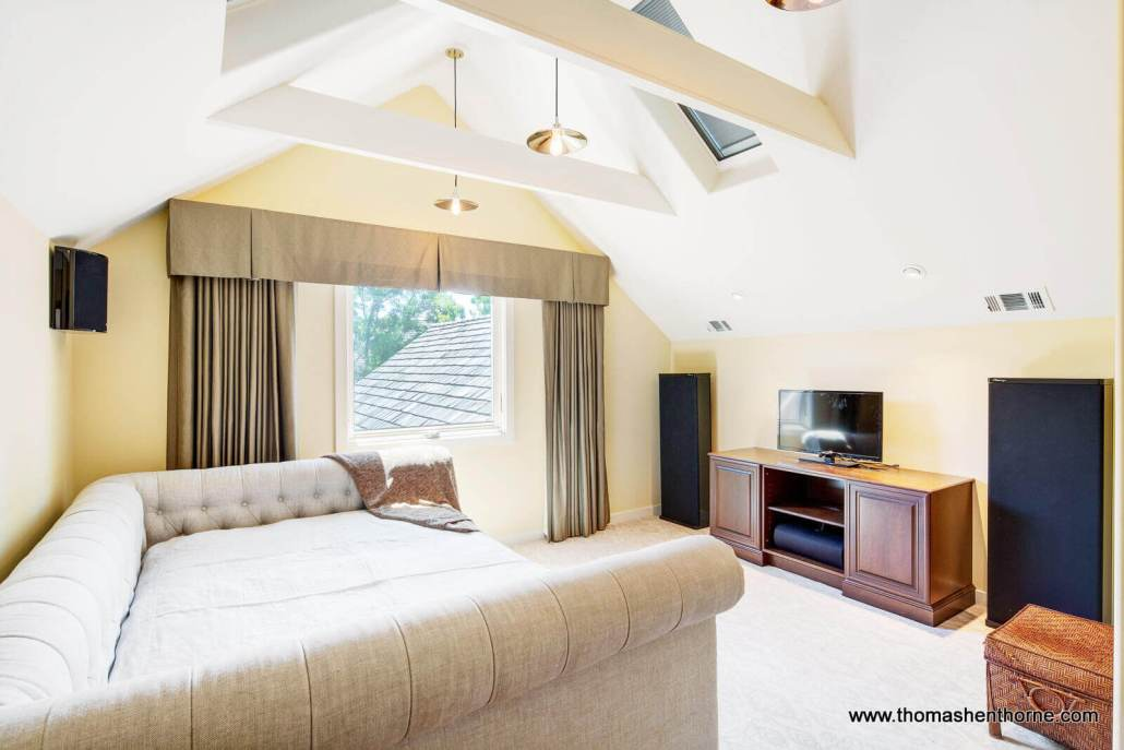 Bright sunny room with cathedral ceiling