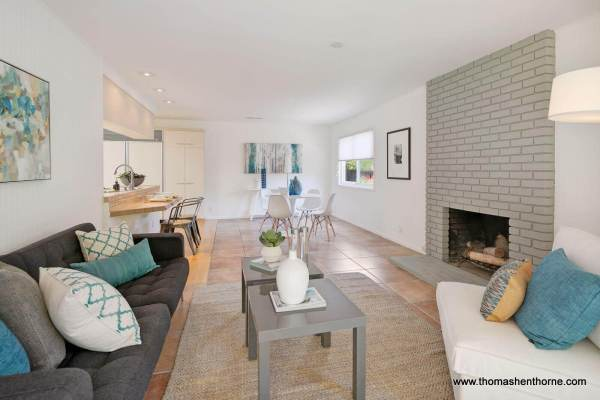 family room with grey brick fireplace