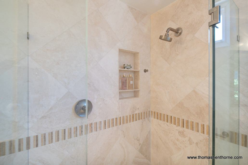 modern shower with tile and glass door