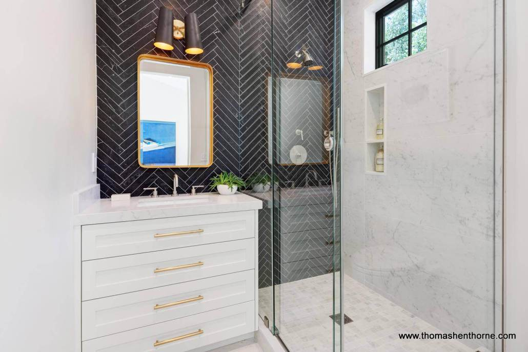 Bathroom with black herringbone tile with white grout