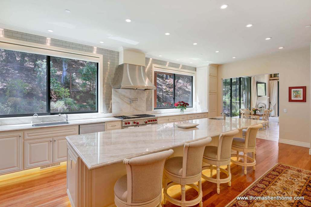 Luxury dream kitchen with quartzite countertops and four bar stools
