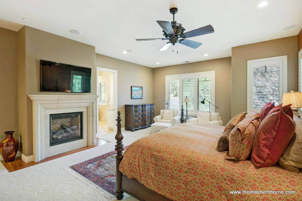 Master bedroom with fireplace and TV