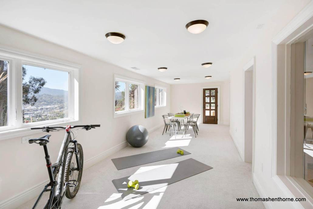 game room with bike and yoga mats