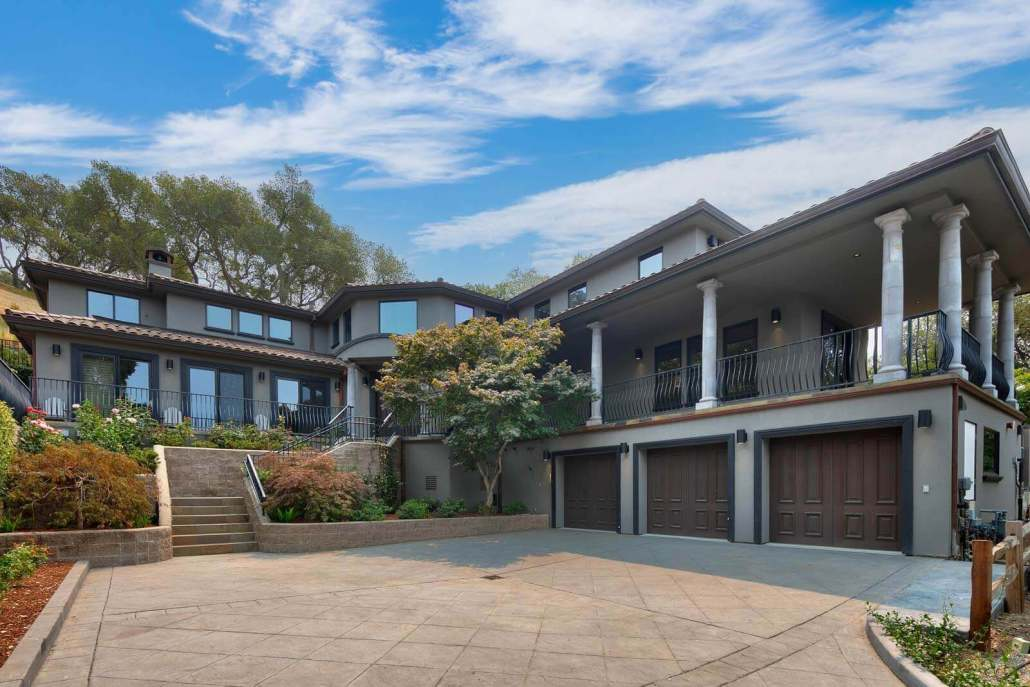home with three car garage and motor court