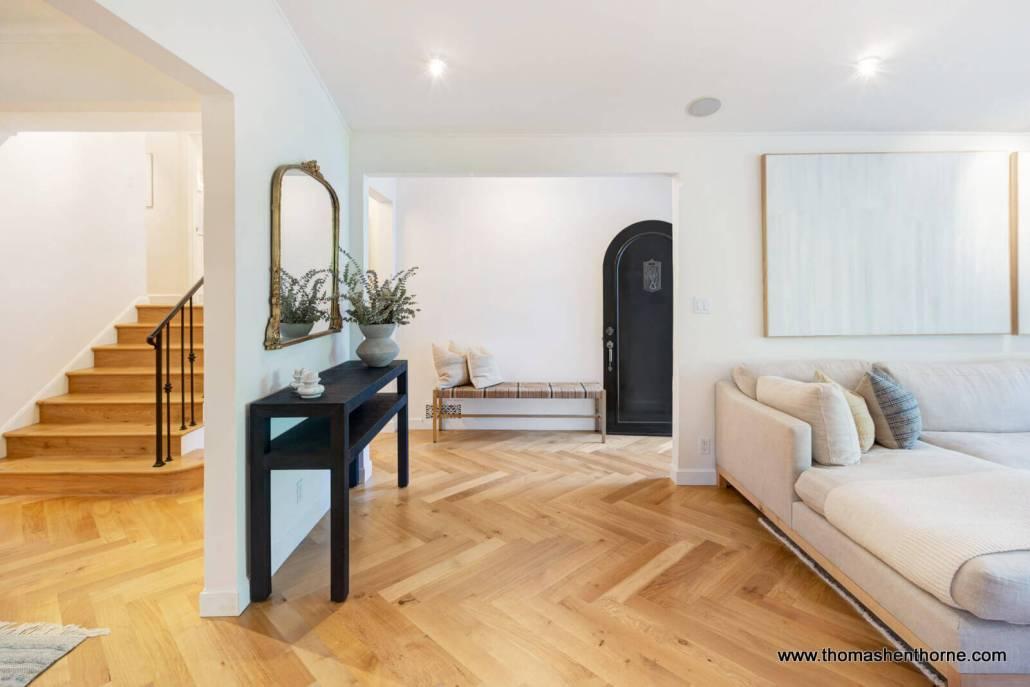 living room with herringbone oak floor