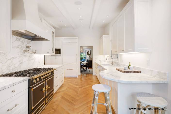 kitchen with wood floors and marble counters