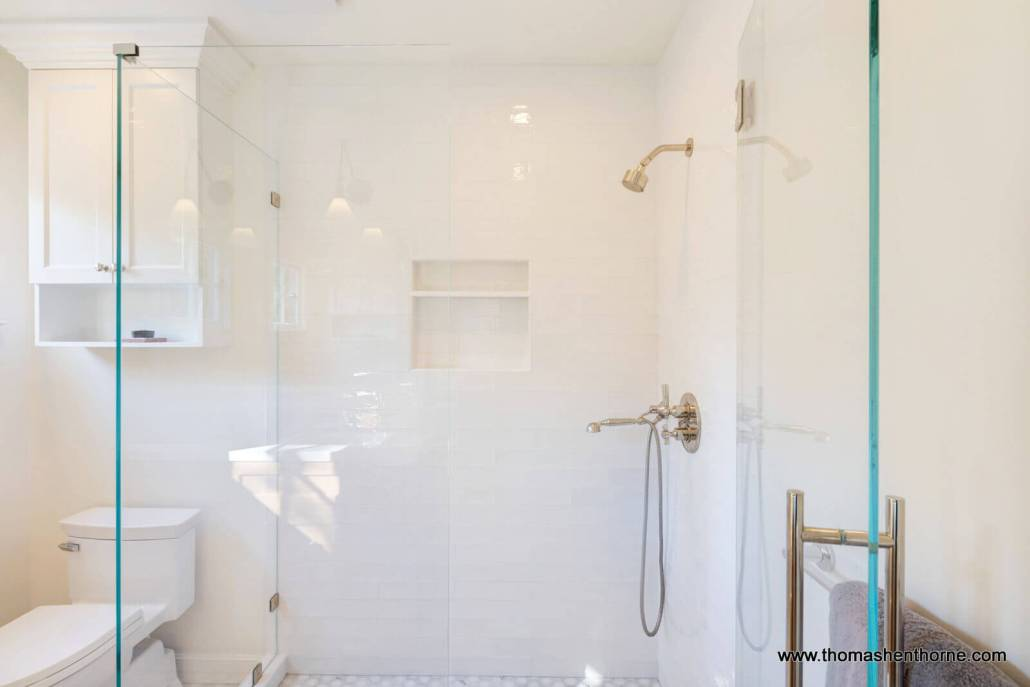 glass enclosed shower with subway tile