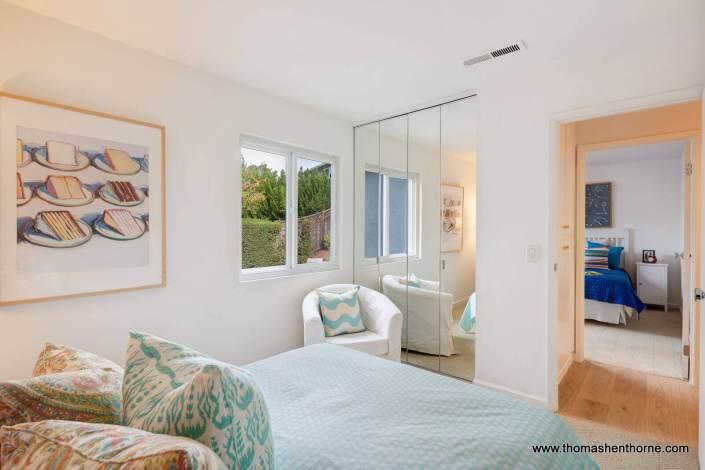 bedroom with mirrored closet door