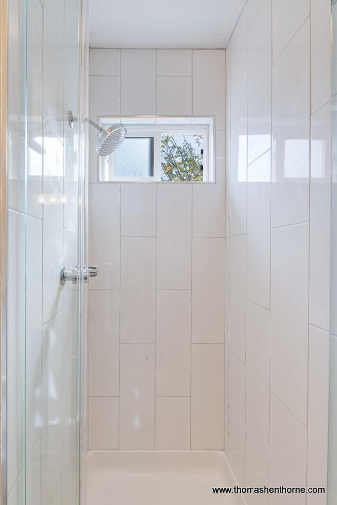 shower with white tile