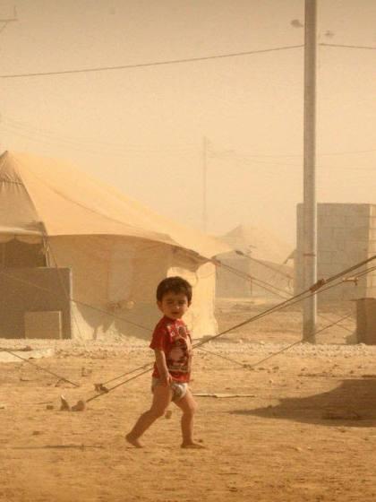 Refugees - Child in Zataari camp, Jordan © Tom Rübenach