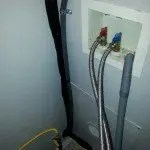 refrigerant lines and electrical ran through utility closet