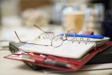 Lesson Plan Topics for any Content Area  Grades 7 12 Eyeglasses on planner at business meeting