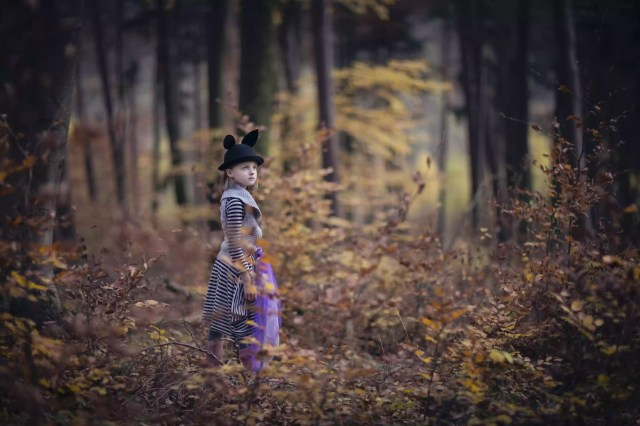 Girl in Autumn woodland