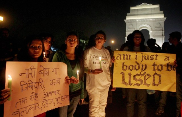 Volunteers of Better India participating in a candle light protest at India Gate in New Delhi on Tuesday condemning the gang rape of a 23-year-old student on a city bus. PTI photo