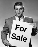 Marketer Holding For Sale Sign