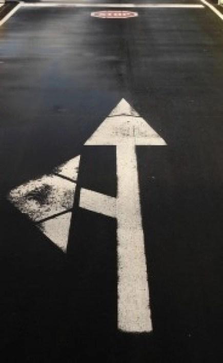 Diverging Arrow on Street