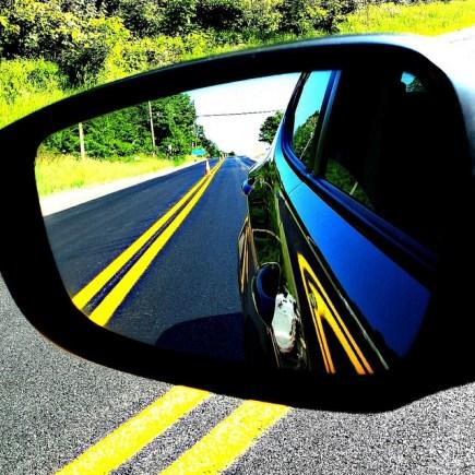 Looking in Rearview Mirror