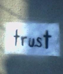 Trust Written in Paint on Sidewalk
