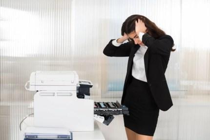 Irritated Businesswoman at Printer
