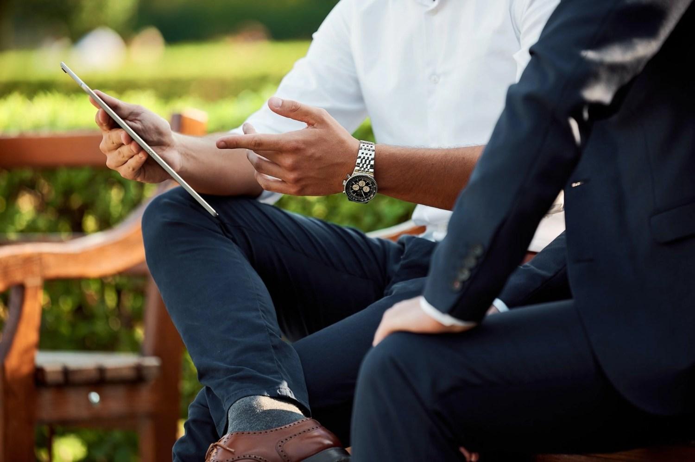 businessmen in park