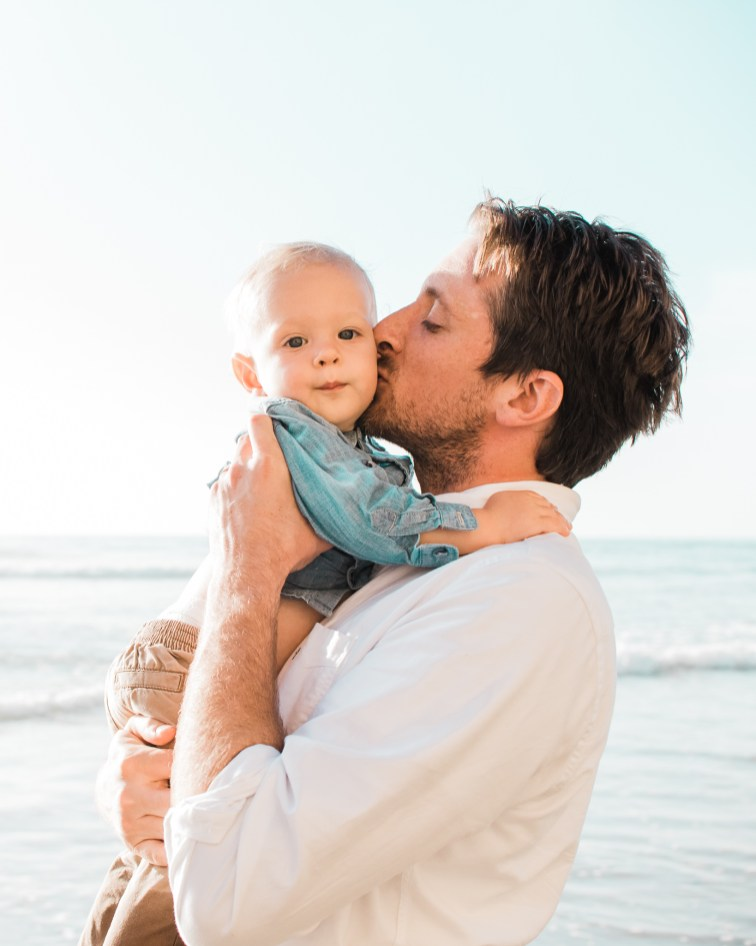 A lifestyle family session at Scripps Pier Beach in San Diego California