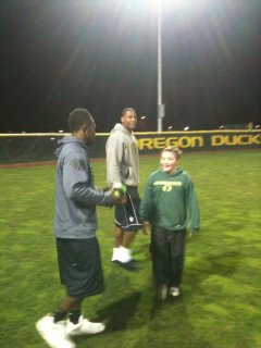 Kenjon Barner and Ed Dickson with Kanen Rossi