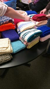 A great pile of scarves ready to package.