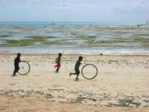Kids running along Jambiani beach