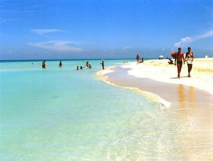 Walking along Playa de Varadero. Varadero Beach, Cuba