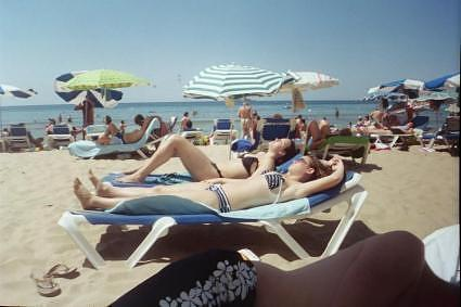 sunbathing on the beaches of benidorm