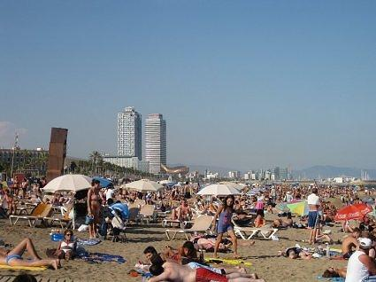 August- crowded beach in Barcelona called Barceloneta