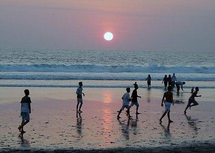 Football at sunset, Legian Beach