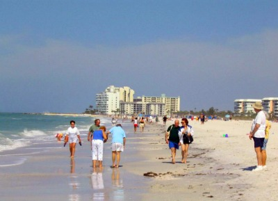 People strolling along St. Pete Beach, Florida