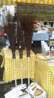 three besom brooms ready to fly