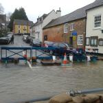 Hambledon hight street looking across the flooded east street from the peoples market