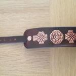 dark brown leather cuff with celtic deisgn