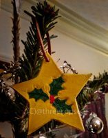 hand carved christmas or festive star with ivy leaves