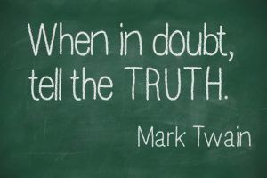 "Famous Mark Twain quote ""When in doubt, tell the truth"" on blackboard"