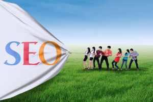 Portrait of business team pulling together a banner of SEO
