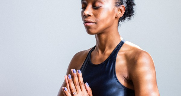 Woman Of Color Sitting In Yoga Prayer Pose