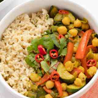 Yellow chickpea curry with red bell peppers, zucchini, and Bok Choy.