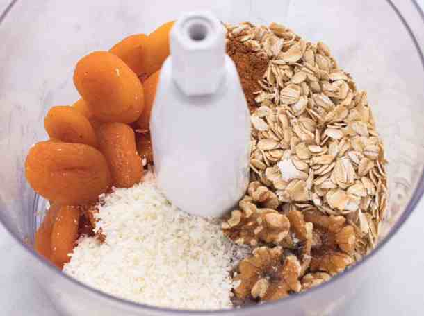 ingredients for apricot energy balls in a food processor