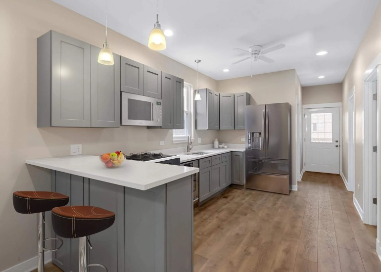Virtual staging services for real estate photography - digital furniture and appliances in a kitchen