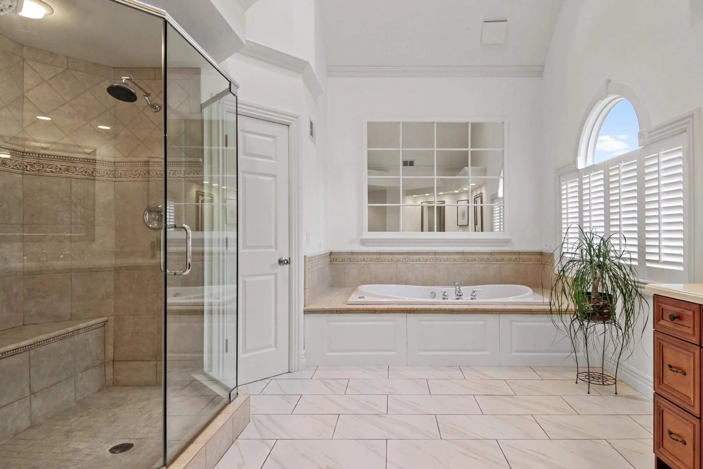 Professional photo of a large master bathroom (primary bathroom)
